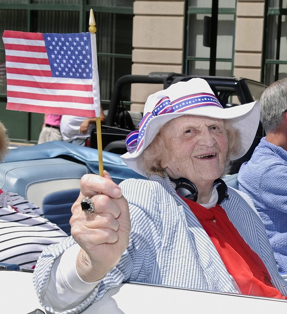 GRAND MARSHAL: Elsie Viles rides down Water Street in Augusta when she was the 2008 Independence Day parade grand marshal.