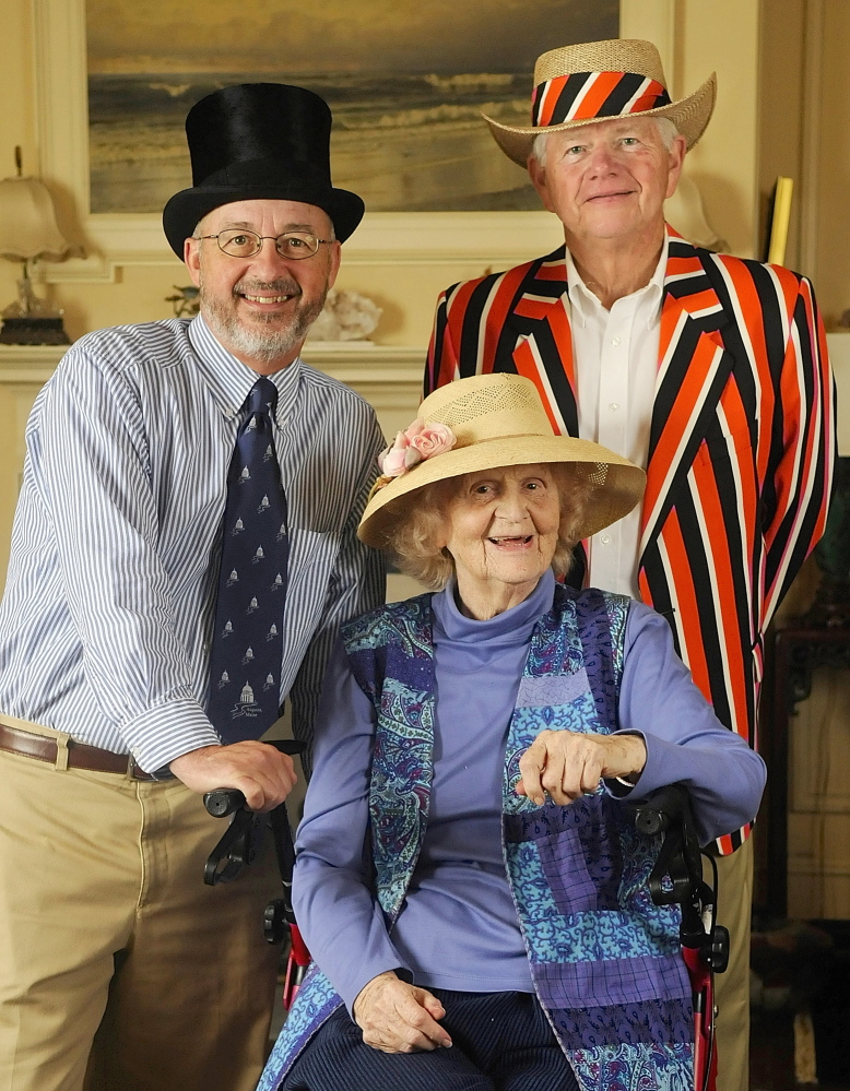 William Bridgeo, Warren Wilson and Elsie Viles model hats at her Augusta home in 2009.