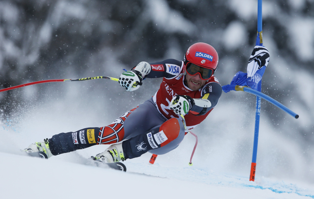 Bode Miller speeds down the course in a World Cup super-g race Sunday in Kitzbuehel, Austria. Miller was second to Didier Defago of Switzerland by 0.05 seconds.