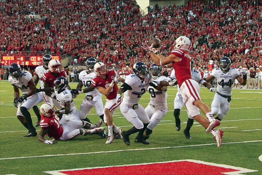 Nebraska wide receiver Jordan Westerkamp catches the game-winning touchdown over Northwestern center back Dwight White, safety Jimmy Hall and linebacker Chi Chi Ariguzo in a college football game in November. Northwestern football players are spearheading an effort to unionize college athletes.