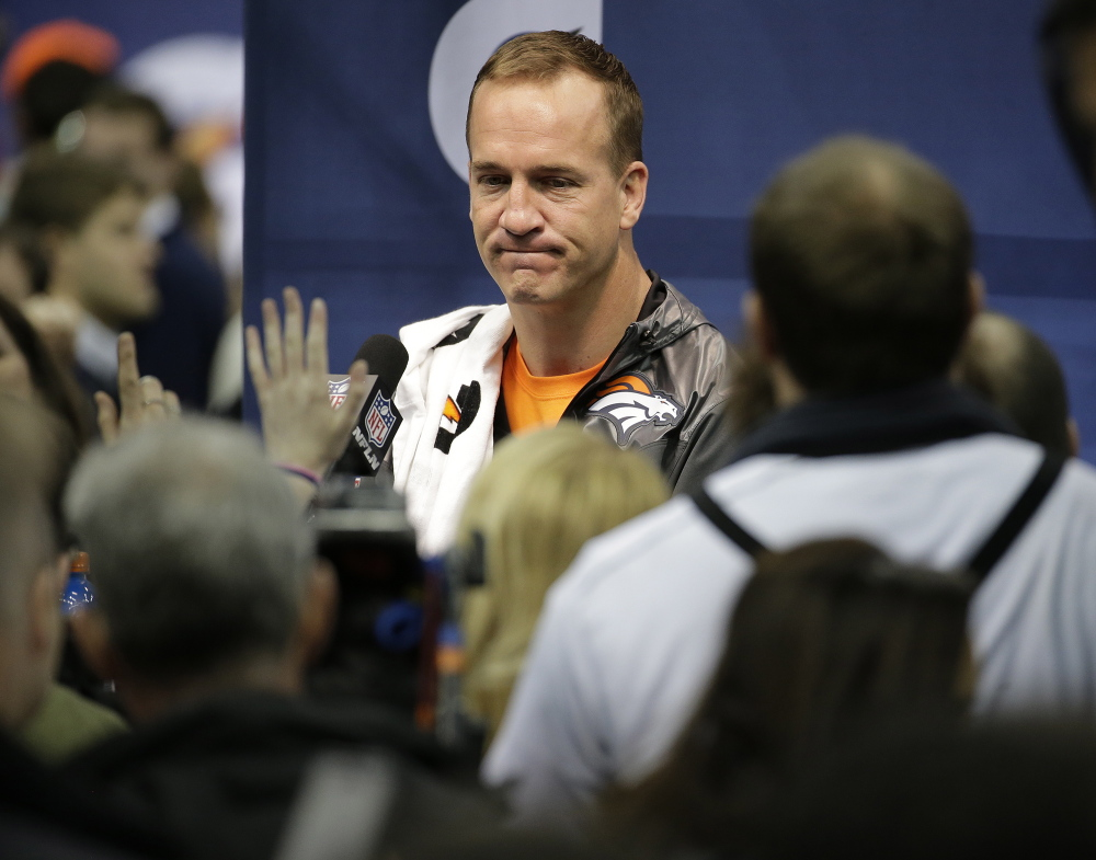 "Denver Broncos' Peyton Manning answers questions during media day for the NFL Super Bowl XLVIII football game on Tuesday in Newark, N.J. ""I've been being asked about my legacy since I was about 25 years old . . . I'm not even 100 percent sure what the word even means."""