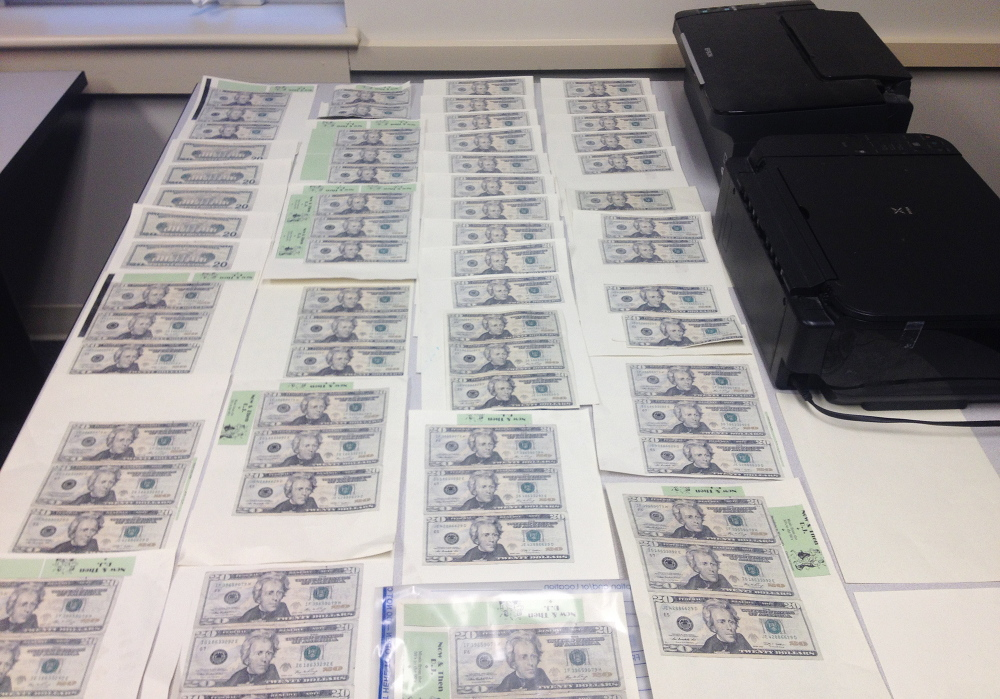 Some of the counterfeit $20 bills authorities seized at the home of Jonathan McDonald.