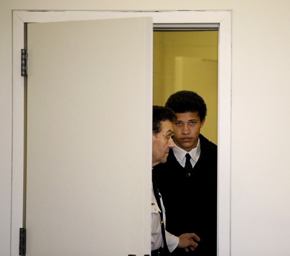 Phillip Chism, 15, from Danvers, Mass., is led into the courtroom at his arraignment on a second charge of rape in Salem Superior Court in Salem, Mass., Thursday.