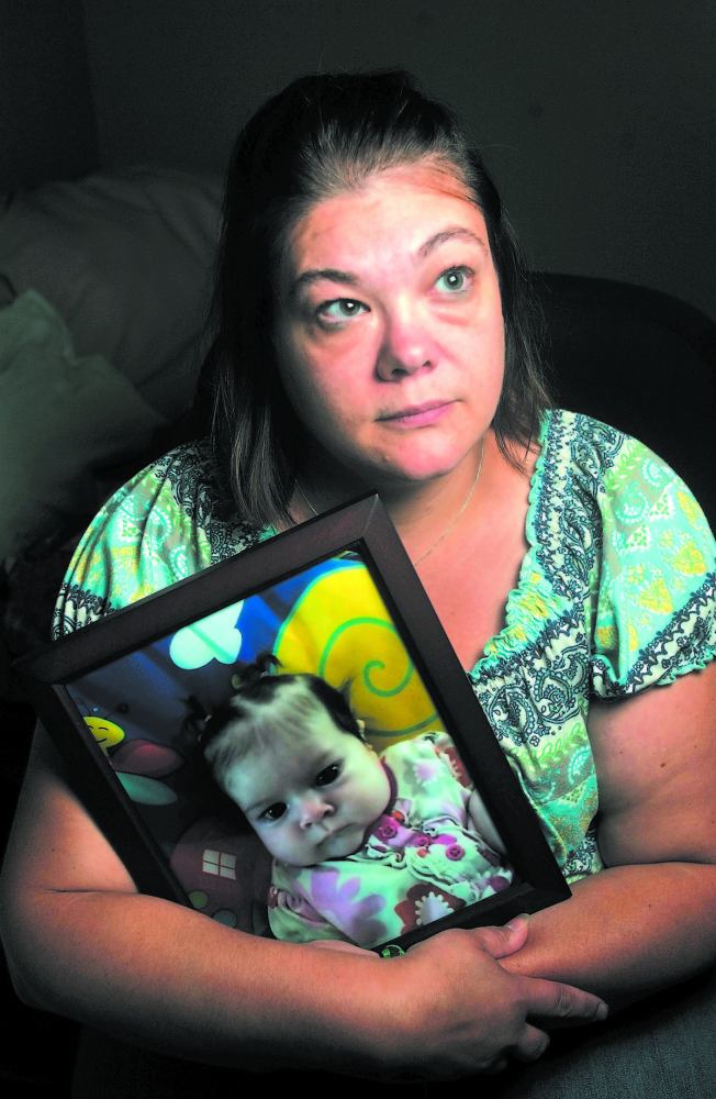 TIME OF MOURNING: Nicole Greenaway holds a picture of her daughter Brooklyn Foss-Greenaway at her home in Clinton. Her 3-month-old baby died while in the care of a friend July 8, 2012.
