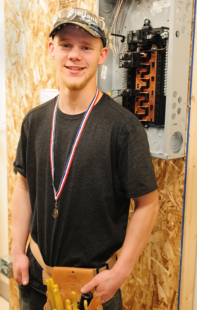 Staff photo First year electrician student Travis Robbin, a junior at Richmond High School, took second place in the SkillsUSA event on Friday January 31, 2014 at the Capital Area Technical Center Augusta.