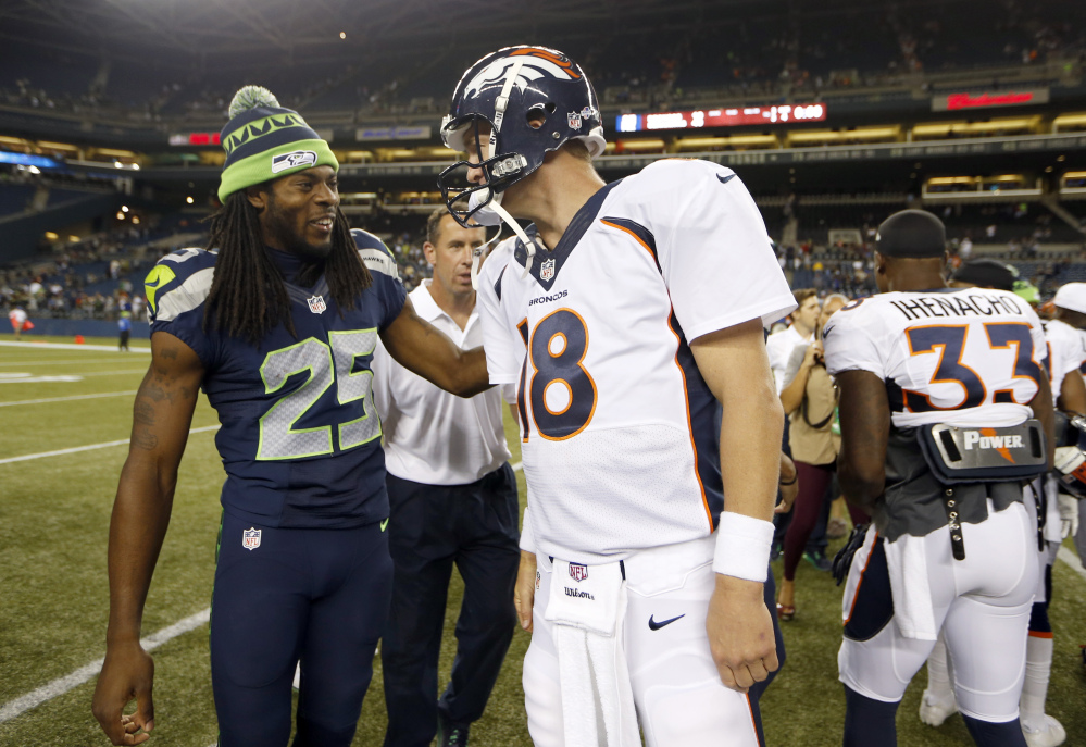 SHOWDOWN: Richard Sherman, left, and the Seattle Seahawks take on Peyton Manning and the Denver Broncos in Super Bowl XLIII on Sunday in E. Rutherford, N.J.