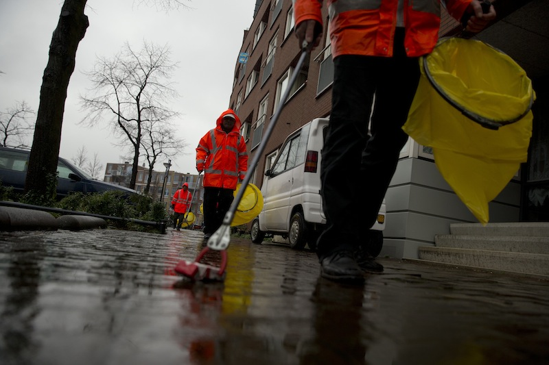 Three alcoholics set out on their daily route to collect litter in Amsterdam on Wednesday.