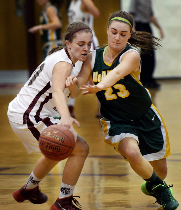 Catherine McAuley's Allie Clement steals the ball from Thornton Academy's Kaitlyn McCrum in girls basketball action Tuesday.