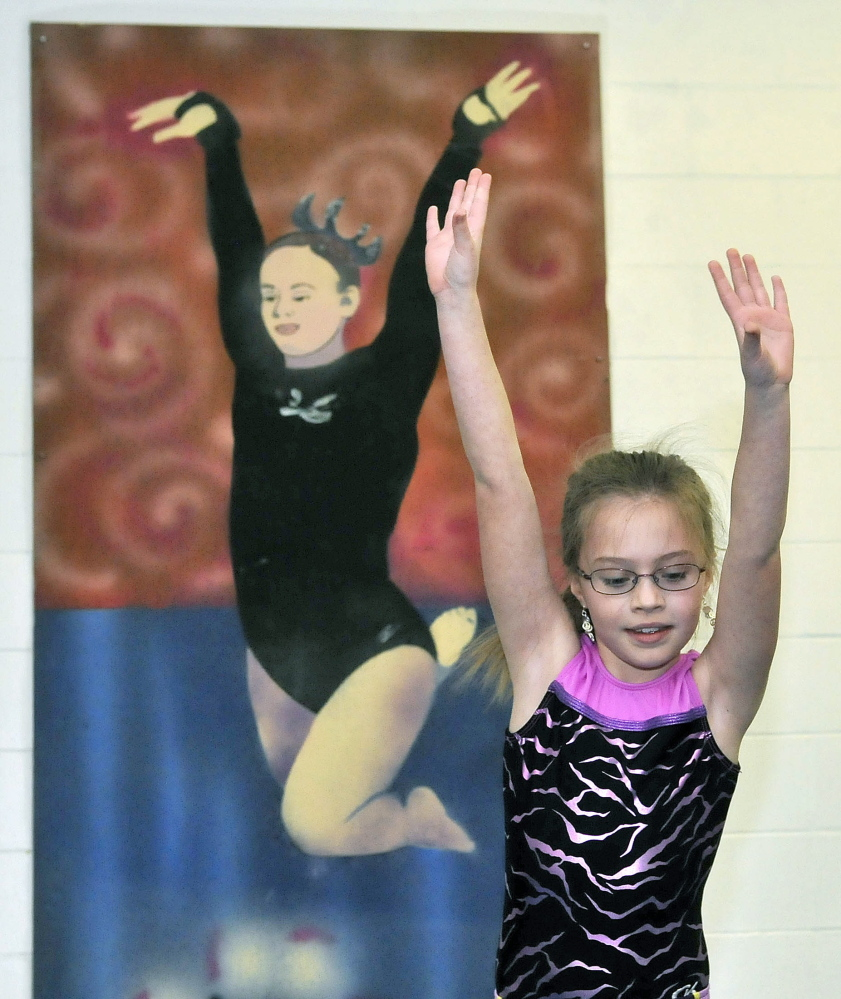 Handy exercise: Courtney Hogan, 10, practices the balance beam at Decal Gymnastics in Farmington on Saturday. Decal re-opened today after closing because of flooding.