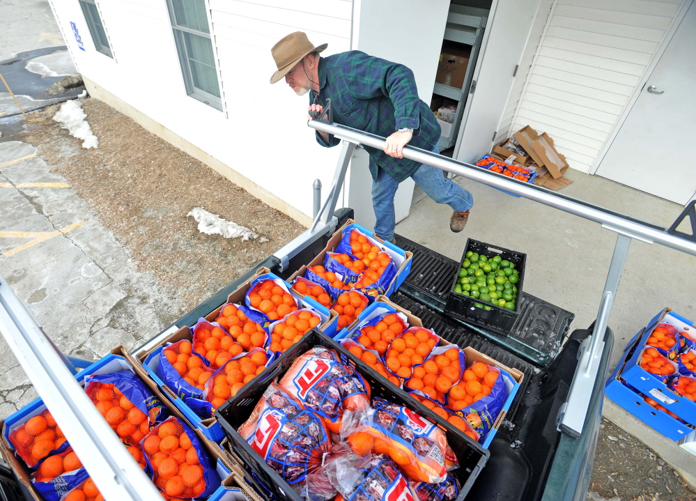 Delivery: Dave Dawson with the Waterville Area Food Bank delivers goods to the United Methodist Church on Pleasant Street in Waterville on Friday.