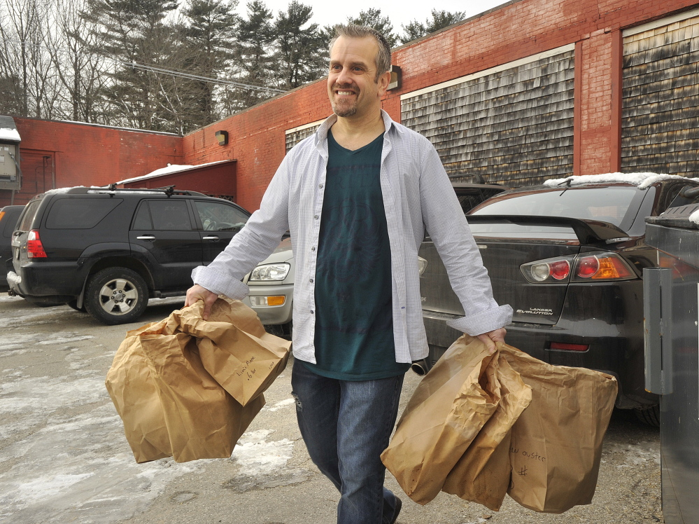 Bountiful Mushrooms Farm general manager and co-owner Scott Payson heads off to make deliveries of newly picked mushrooms to area restaurants. Tuesday, January, 21, 2014. John Ewing/staff Photographer.