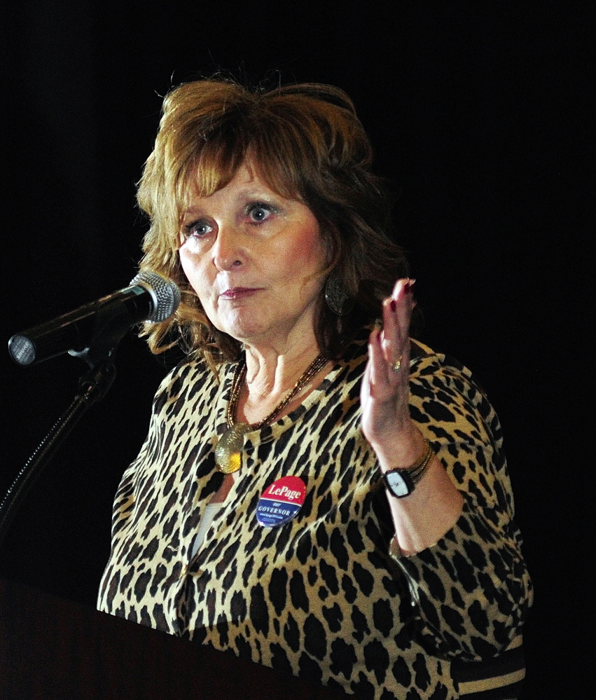 Touting the party: First Lady Anne LePage speaks during the Kennebec County Republican Caucus on Saturday at Cony High School in Augusta.