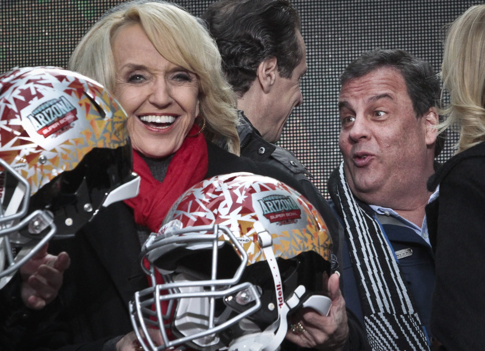 Arizona Gov. Jan Brewer, left, react for photos as New York Gov. Andrew Cuomo, center, and New Jersey Gov. Chris Christie, right, leave after a ceremony to pass official hosting duties of next year's Super Bowl to Arizona on Saturday.