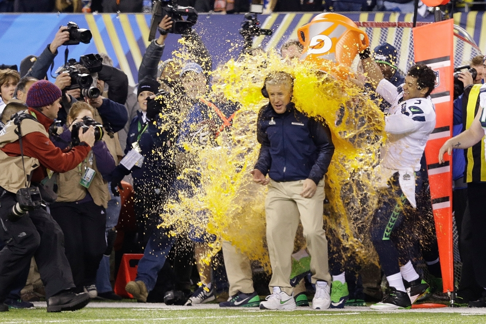 Seattle Seahawks head coach Pete Carroll is doused with Gatorade late in the second half of the NFL Super Bowl XLVIII football game Sunday, Feb. 2, 2014, in East Rutherford, N.J. The Seahawks won 43-8.