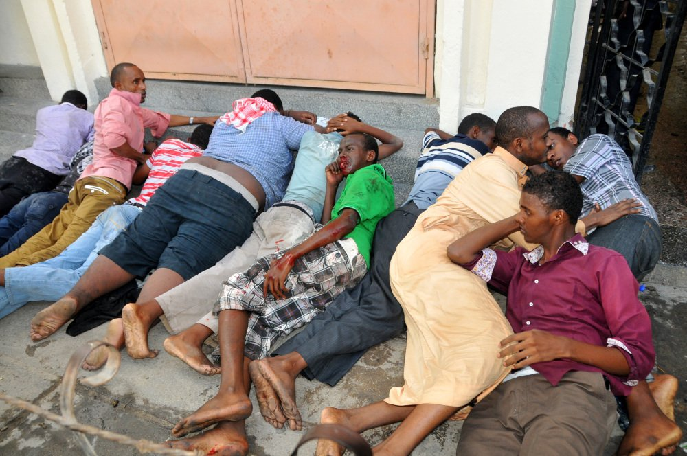 Some of the Muslim youths lie on the ground after they were arrested inside the Masjid Musa Mosque during riots in Mombasa between Muslim youths and riot police in Majengo, Mombasa, Kenya, on Sunday.