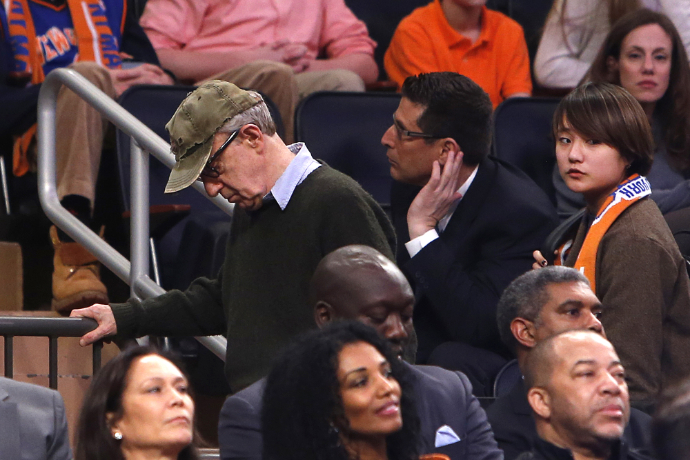 Filmmaker Woody Allen, left, leaves late in the fourth quarter of Saturday's Knicks game at Madison Square Garden. Dylan Farrow renewed molestation allegations against Allen, claiming he sexually assaulted her when she was 7 after he and actress Mia Farrow adopted her.
