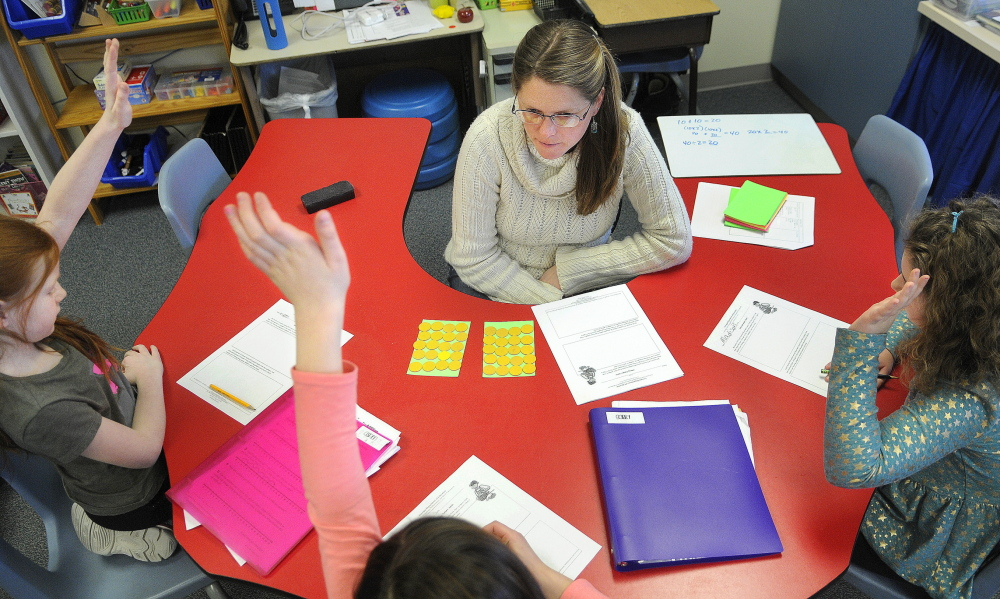 """TALKING NUMBERS: Readfield Elementary School third grade teacher Abby Shink leads her class Wednesday through a """"number talk,"""" an instructional activity RSU 38 uses to get students to discuss and critique arguments in math, as required in the Common Core State Standards."""
