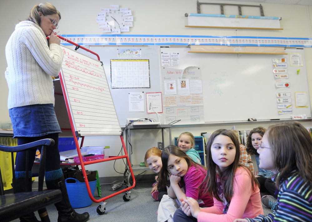 """TALKING NUMBERS: Readfield Elementary School third grade teacher Abby Shink listens Wednesday to her class work through an equation with a """"number talk,"""" an instructional activity RSU 38 uses to get students to discuss and critique arguments in math, as required in the Common Core State Standards."""