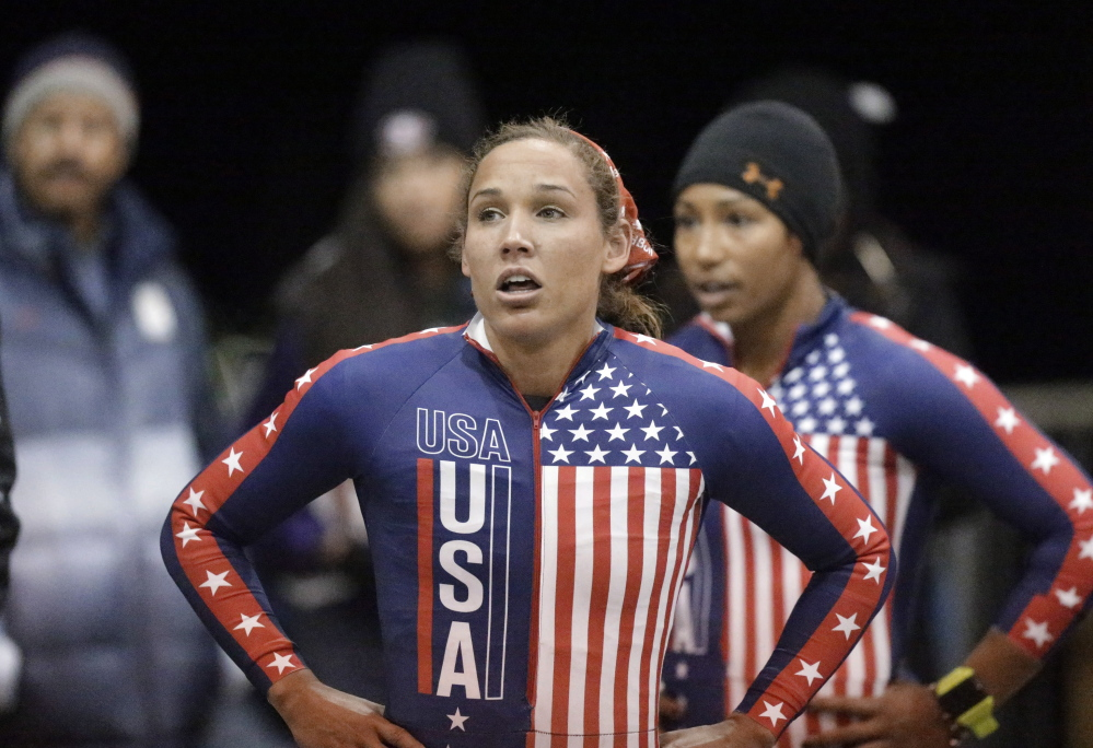 In this Oct. 25, 2013, photo, Lolo Jones, foreground, and teammate Jazmine Fenlator look up after racing in the U.S. women's bobsled team Olympic trials in Park City, Utah. Jones has gotten ill at the Sochi Olympics. Jones tweeted Monday, Feb. 10, 2014, that she was in a