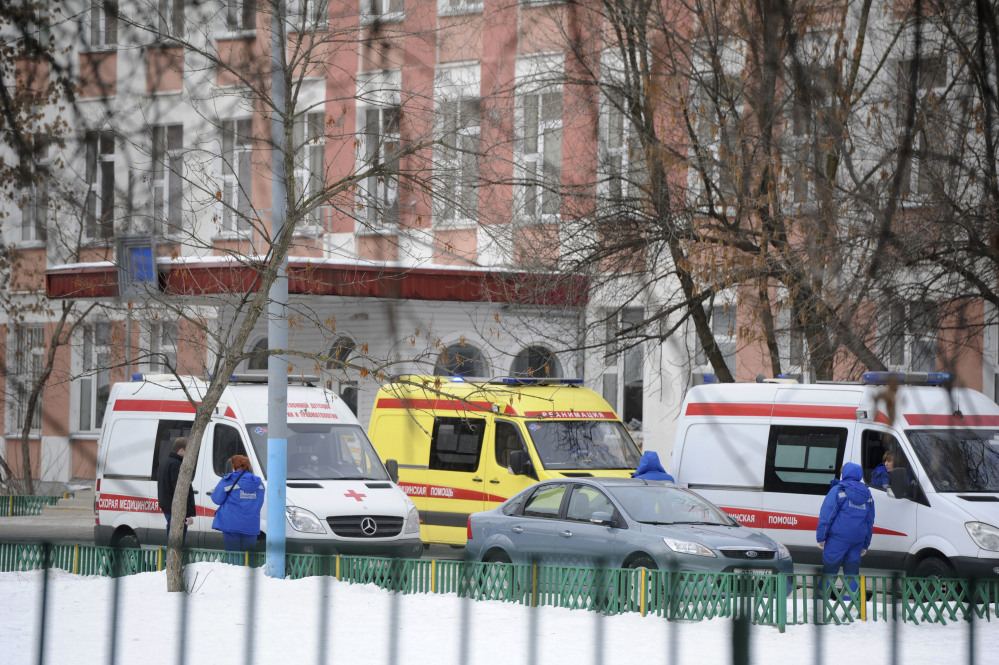Ambulances are parked Monday at an entrance to a school in Moscow, Russia, where police said an armed teenager burst into the school and killed a security guard and a teacher before being taken into custody.