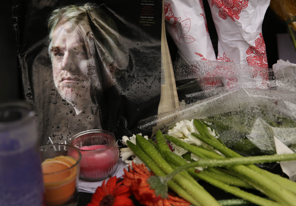 A makeshift memorial is seen Monday outside the building where the body of actor Philip Seymour Hoffman was found in New York.