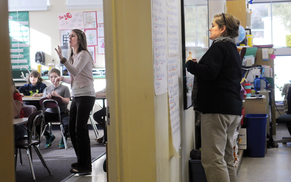 CRUNCH: Fourth grade teachers Gretchen Nickerson, left, and Sarah Hanley instruct in a room at Helen Thompson School in West Gardiner that is divided by a temporary wall. Nickerson teaches in the former life skills space while Hanley uses the former art studio for their classrooms.
