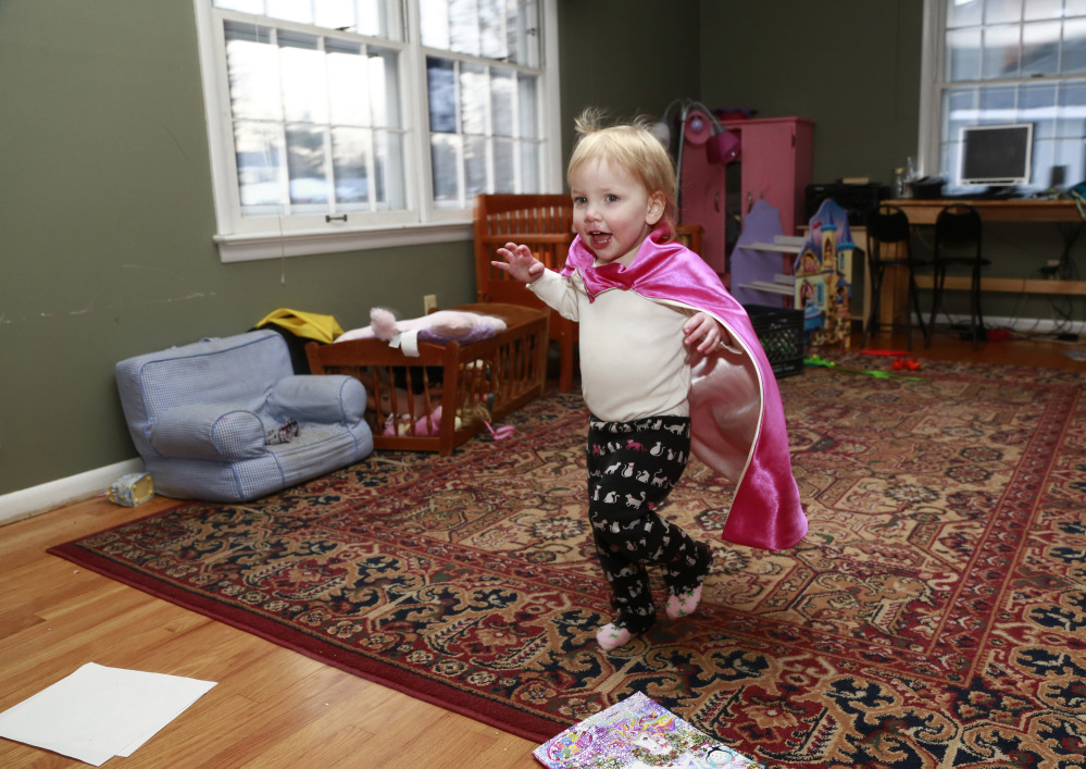 Felicity Beck-Kehoe runs through the family home of her parents Mike Beck and Joanne Kehoe as the family tries to combat cabin fever Monday in Indianapolis.