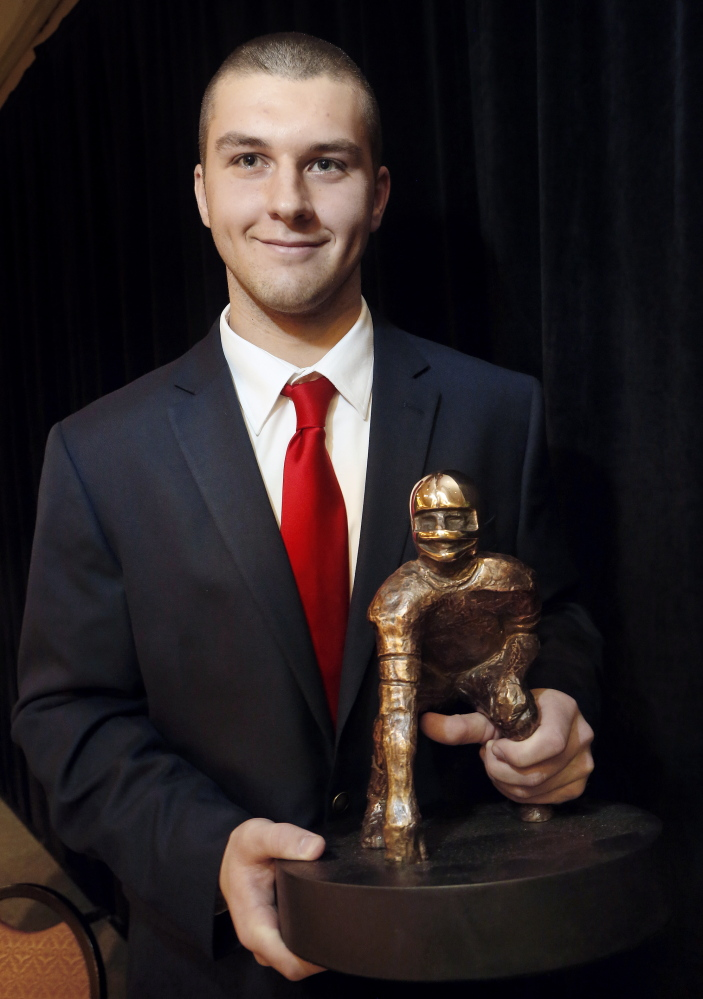 MOVING ON: Ben Lucas, quarterback for Cony High School, won the James L. Fitzpatrick Trophy last minth at Holiday Inn by The Bay in Portland. Lucas, who finished his high school career with 7.575 yards and 89 touchdowns, will sign with the University of Maine today.