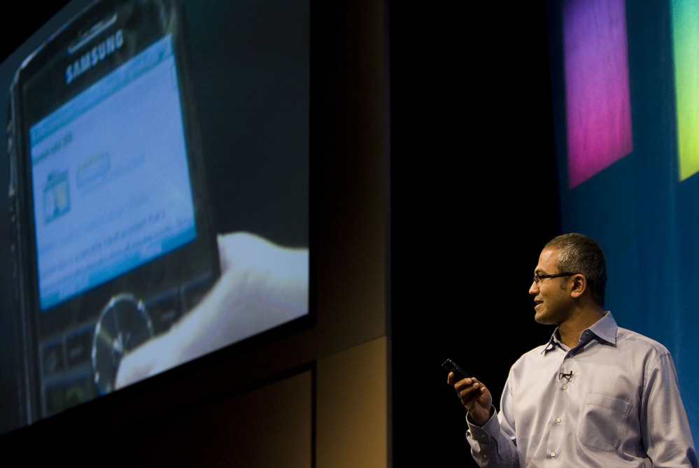 Satya Nadella demonstrates some of the features of Live Search on a mobile device at the company's campus in Redmond, Wash.