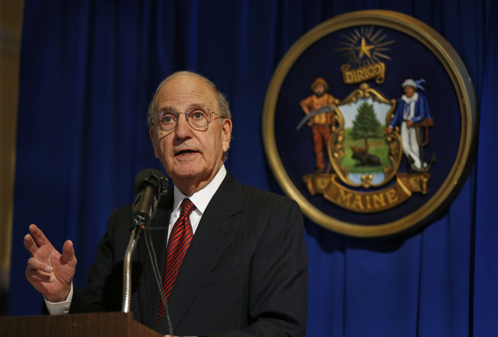 native son: Former U.S. Sen. George Mitchell speaks after the unveiling of his portrait at the State House in Augusta in Tuesday.