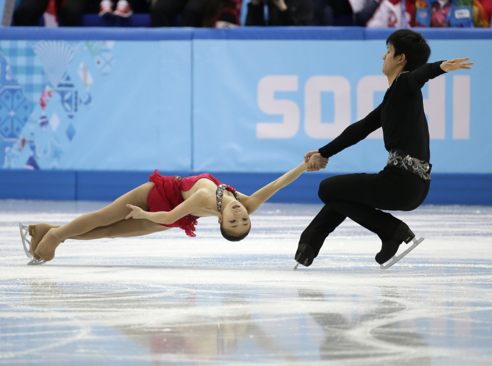Narumi Takahashi and Ryuichi Kihara of Japan compete in the team pairs short program figure skating competition at the Iceberg Skating Palace during the 2014 Winter Olympics, Thursday, Feb. 6, 2014