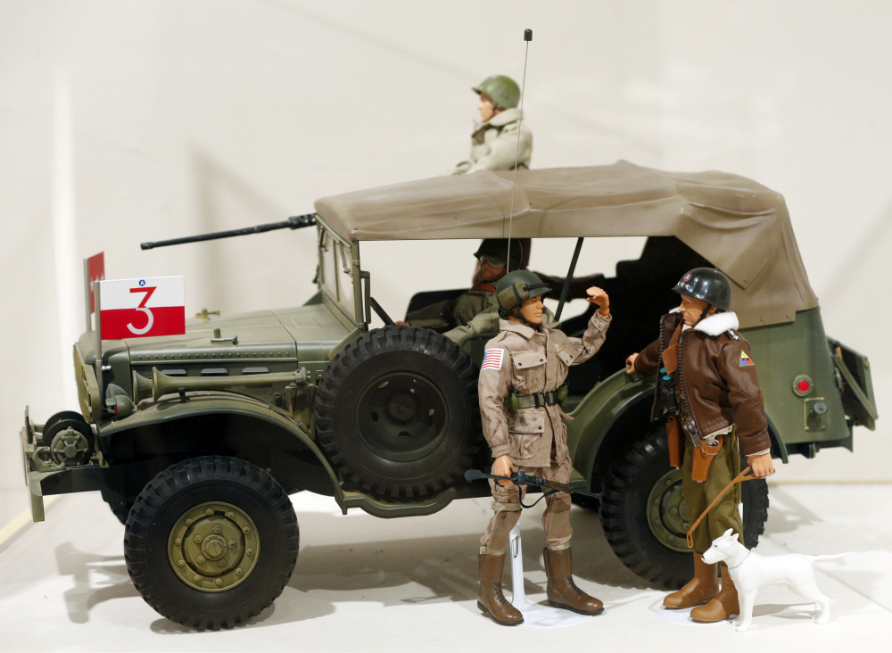 A Gen. George Patton G.I. Joe action figure, right, and other G.I. Joes in a display at the New York State Military Museum in Saratoga Springs, N.Y.