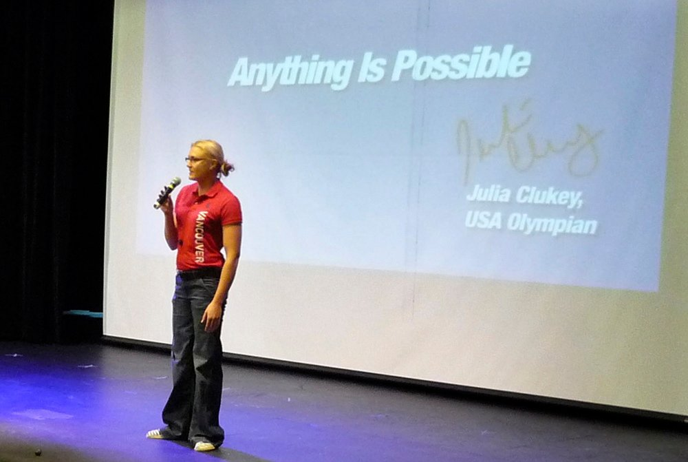 Photos courtesy of Maine Beer & Wine Distributors Association OLYMPIAN ON STAGE: Augusta native Julia Clukey speaks to the students at Winthrop High School.