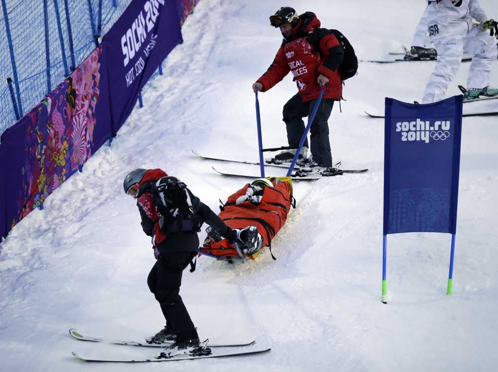 Heidi Kloser is stretchered off the course Thursday after crashing in a warmup run before qualifying in the women's moguls at the Rosa Kutor Exreme Park ahead of the 2014 Winter Olympics in Krasnaya Polyana, Russia.