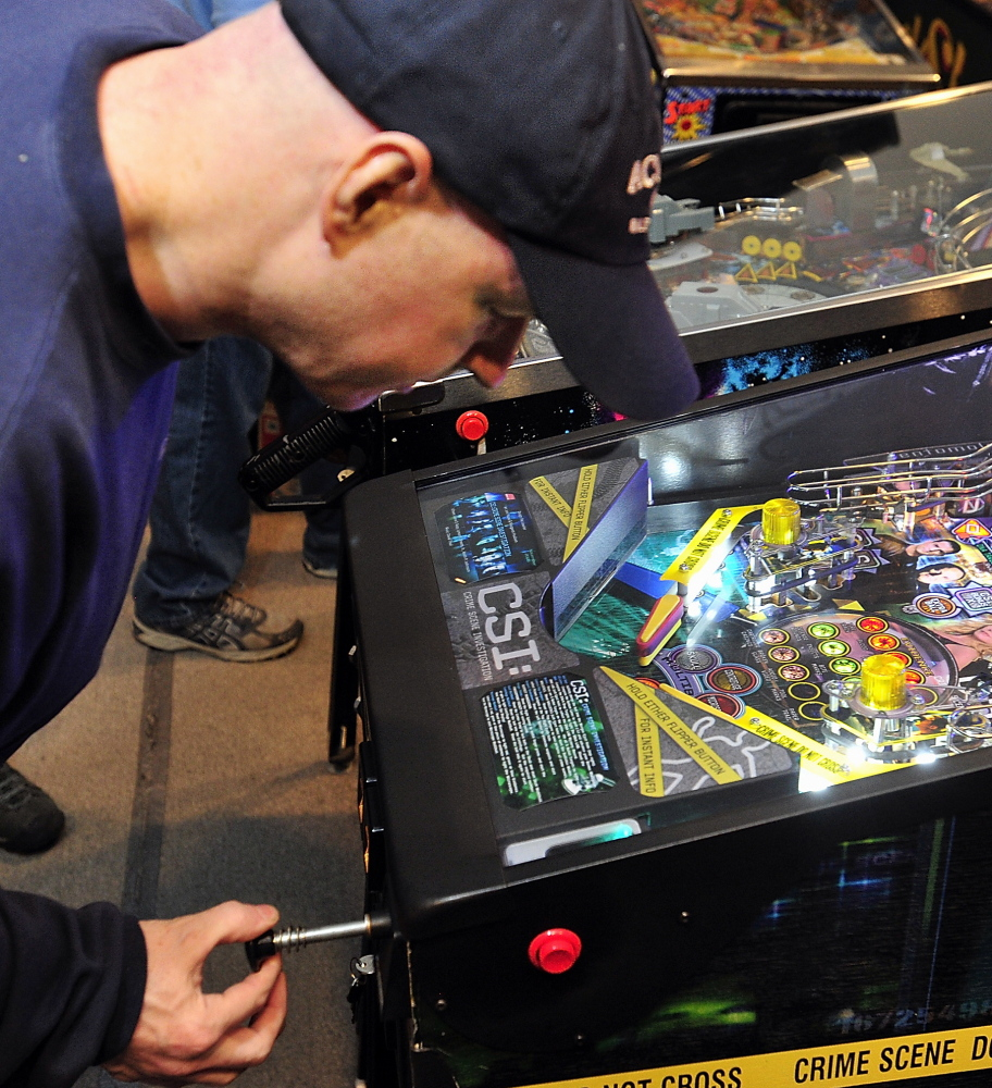 Jerry Lindsay of Oakland sets the plunger to shoot his ball into the game at the Maine State Pinball Championship in Gorham on Saturday.