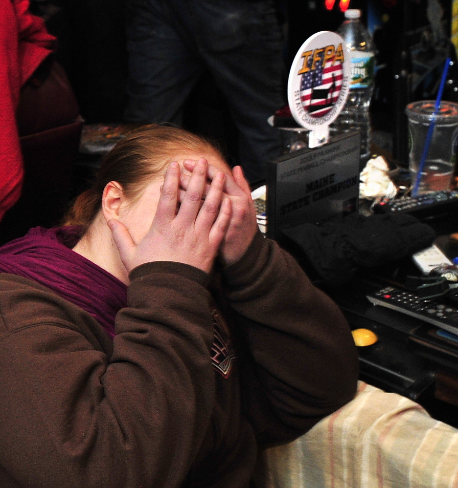 Theresa Nessel of Portland buries her face in her hands after losing a game on her last ball.
