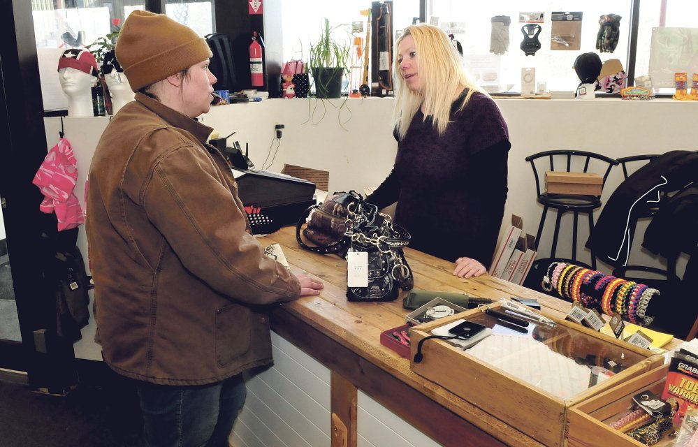 OPEN FOR BUSINESS: Bargain Hunter store owner Aimey Ribeiro, right, waits on customer Renee Reynolds at the Skowhegan business recently.