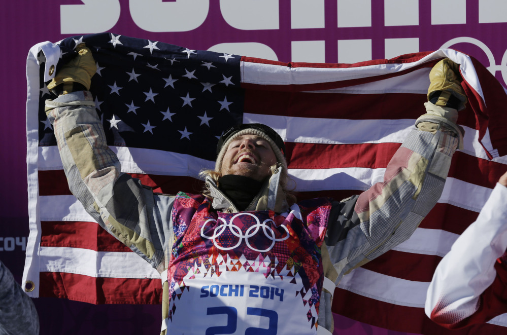 American Sage Kotsenburg celebrates after winning the men's snowboard slopestyle final at the Rosa Khutor Extreme Park on Saturday at the Sochi Olympics.