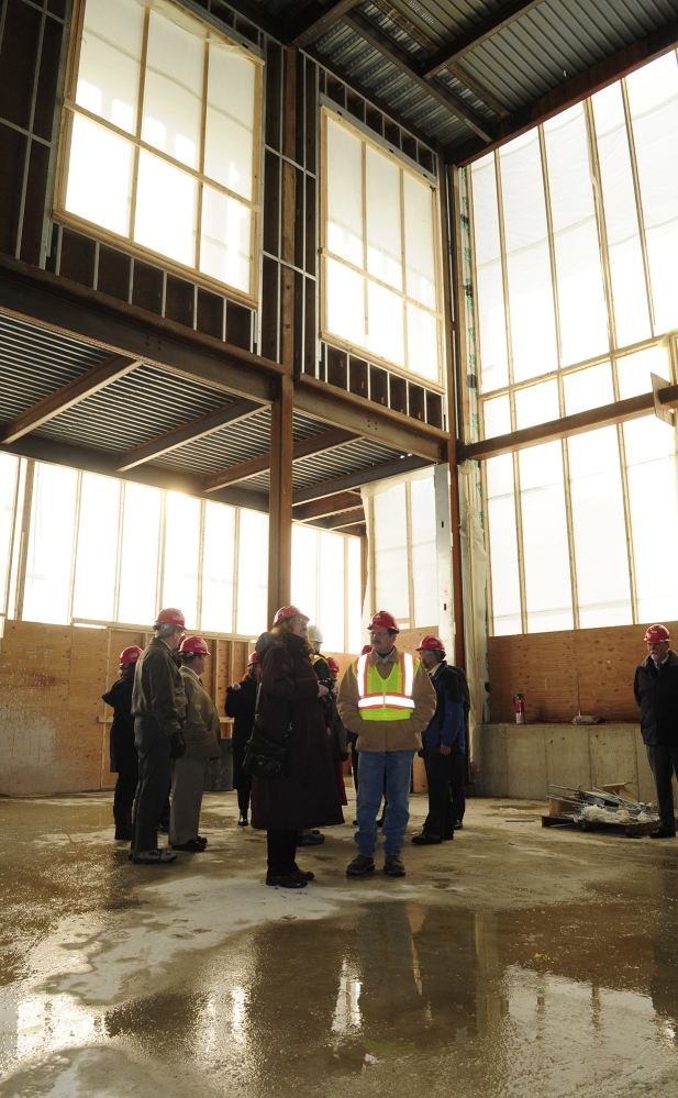 Courthouse progress: During a tour, the Legislature's Judiciary Committee stands in the entryway of the new court building on Thursday in Augusta.