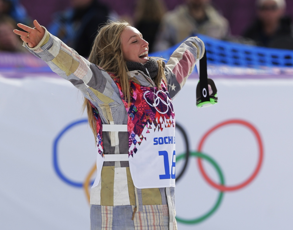 Jamie Anderson of the United States celebrates on the way to the flower ceremony after winning the women's snowboard slopestyle final at the 2014 Winter Olympics on Sunday in Krasnaya Polyana, Russia.