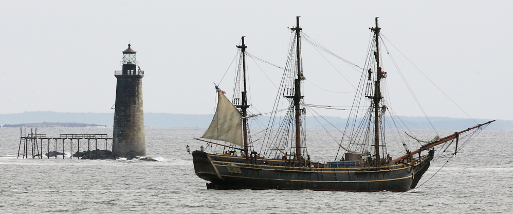 """The Bounty motors past Ram Island Ledge Lighthouse off Cape Elizabeth. The 108-foot-long, three-masted ship was a replica of the 18th-century British ship HMS Bounty. It was built in 1960 for the movie """"Mutiny on the Bounty"""" and appeared in several other films, including one """"Pirates of the Caribbean"""" movie."""