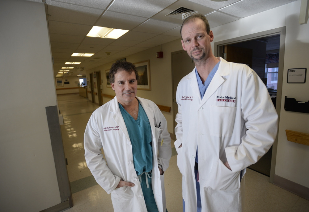 """Dr. David Butzel, right, shown with Dr. Scott Buchanan, says creation of a special cardiac operating room will reduce wait time for the """"very, very ill."""""""