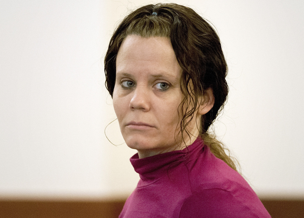 Julie Corey is shown in court in Worcester, Mass., on Wednesday before a jury declared her guilty of killing her pregnant friend Darlene Haynes in 2009 and cutting the baby from Haynes' womb.