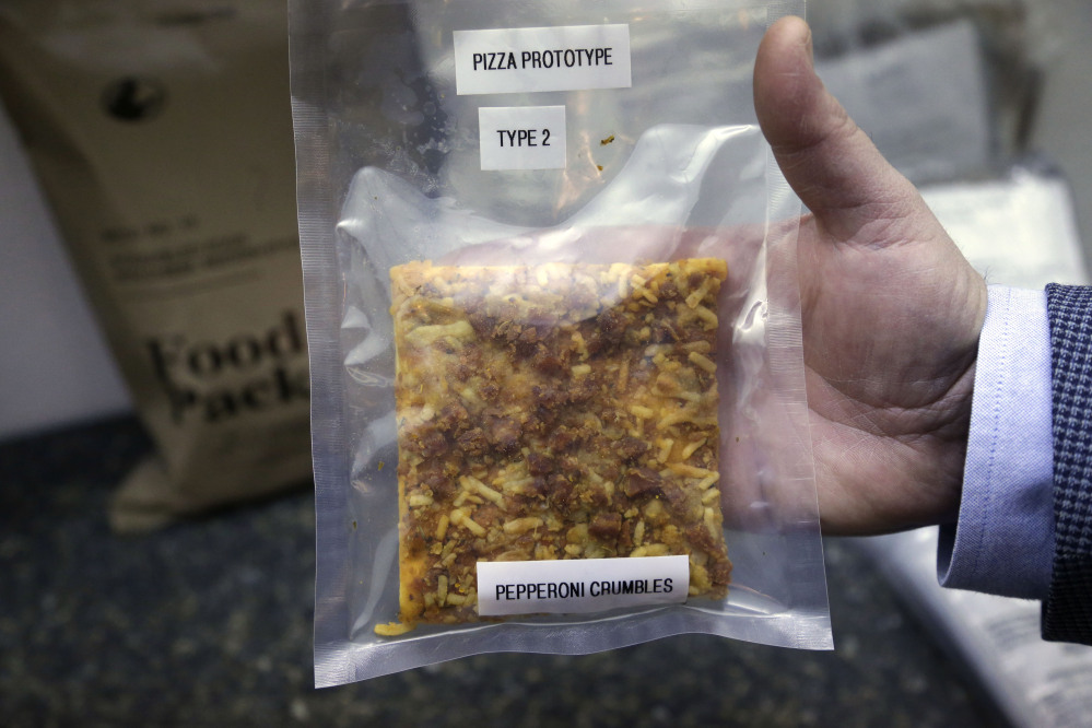 A packet containing a slice of prototype pizza is at the U.S. Army Natick Soldier Research, Development and Engineering Center, in Natick, Mass.