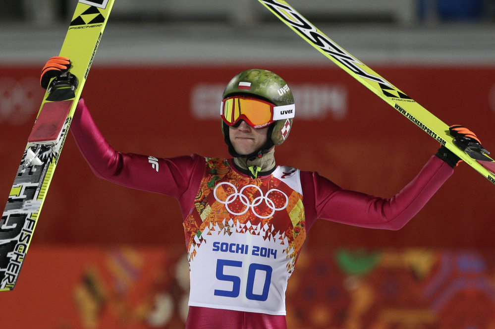 Poland's Kamil Stoch celebrates winning the gold during the ski jumping large hill final at the 2014 Winter Olympics on Saturday in Krasnaya Polyana, Russia.