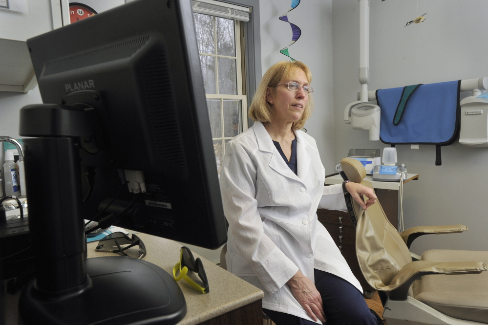 Cathy Kasprak, a dental hygienist who owns a practice in Bridgton, wants to become a dental therapist. Maine is considering a controversial bill to create the mid-level provider position, which combines the services of a hygienist with some of those offered by dentists.