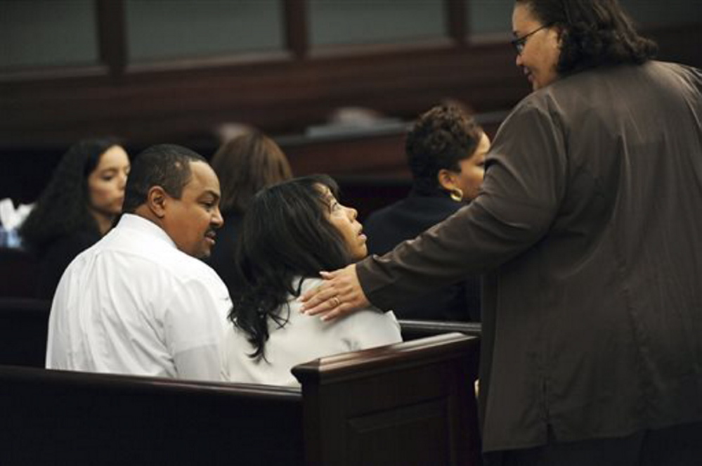 Lucia McBath, center, mother of Jordan Davis, is greeted by an unidentified woman who sat with the family in the courtroom on Saturday in Jacksonville, Fla. Her husband, Curtis McBath sits to her left. After its fourth day of deliberations, a jury found Michael Dunn guilty on three counts of attempted second-degree murder in the fatal shooting of 17-year-old Davis after an argument over loud music outside a Jacksonville convenient store in 2012.