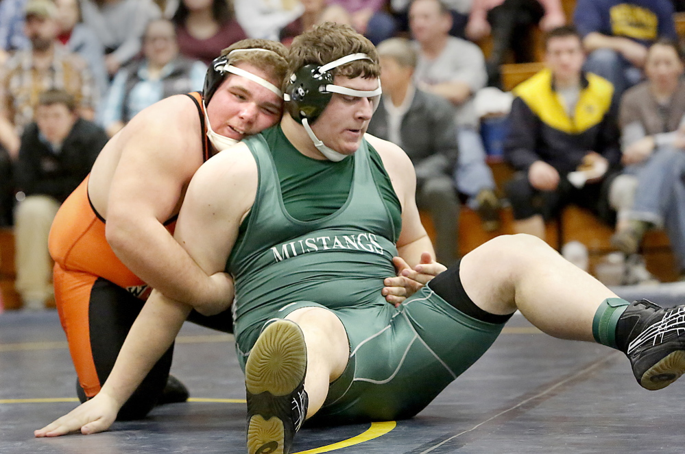 Tim Greenway/Staff Photographer Aaron Lint, left, of Winslow grapples with Chris Cole of Mt. View during their 285-pound semifinal at the Class B meet. Lint pinned Cole, then won the championship with another pin.