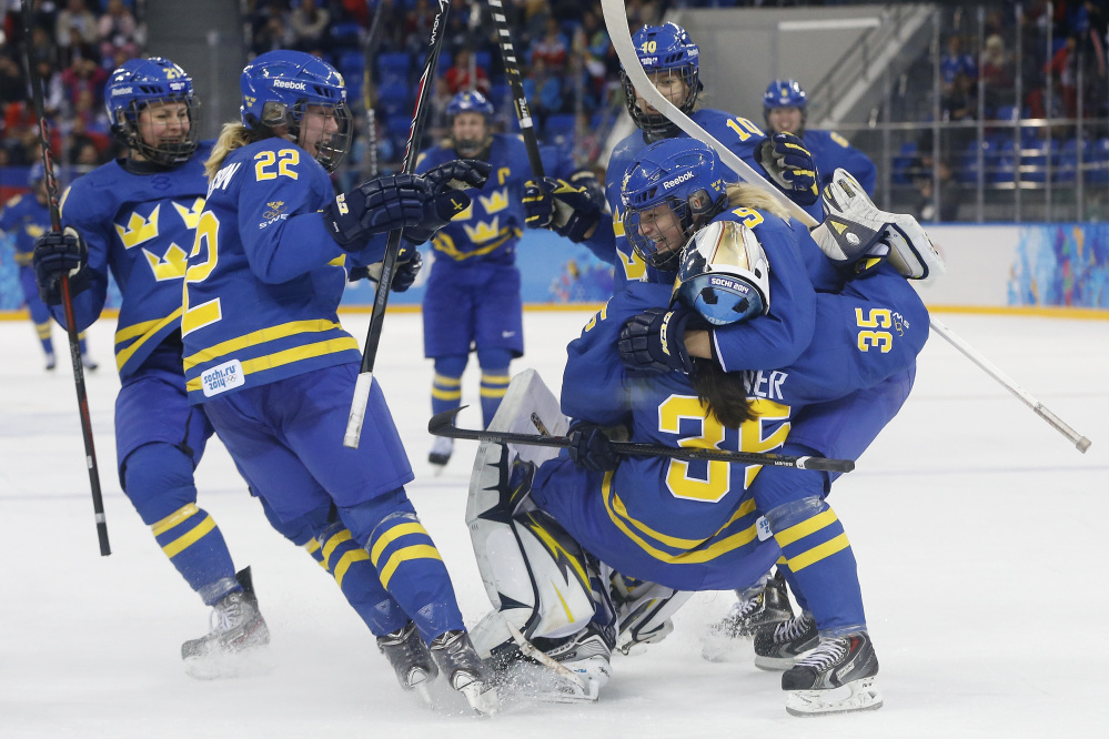 Team Sweden celebrates this a4-2 victory over Finland during the 2014 Winter Olympics women's hockey quarterfinal game at Shayba Arena on Saturday in Sochi, Russia. Sweden will play the United States in the semifinals.