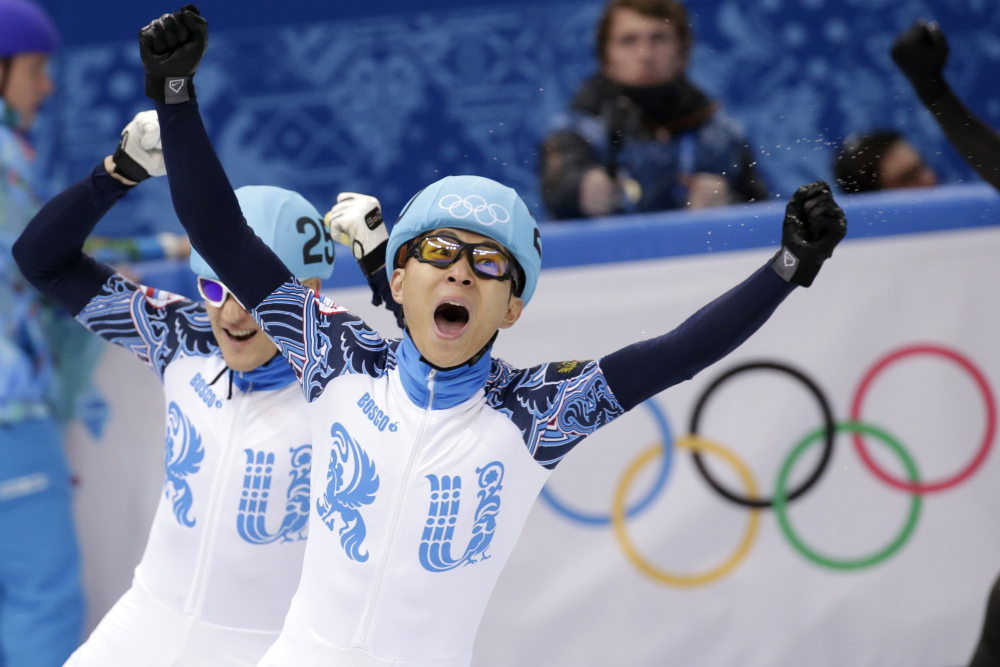 Viktor Ahn of Russia, right, celebrates winning in a men's 1,000-meter short track speedskating final alongside Vladimir Grigorev of Russia, who placed second, at the Iceberg Skating Palace during the 2014 Winter Olympics in Sochi, Russia.